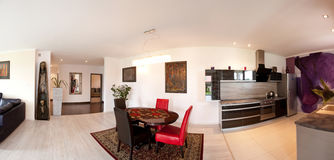 Interior of modern home. Panorama of interior of modern home including dining and living rooms Royalty Free Stock Photos