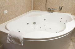Interior of a modern hotel bathroom, jacuzzi. Royalty Free Stock Images