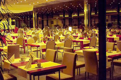 Interior of a modern hotel restaurants. Modern interior of the restaurant with night-lighting Royalty Free Stock Photography