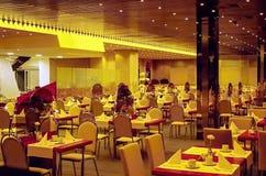 Interior of a modern hotel restaurants. Modern interior of the restaurant with night-lighting Royalty Free Stock Photo