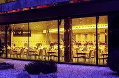 Interior of a modern hotel restaurants. Modern interior of the restaurant with night-lighting Royalty Free Stock Photos