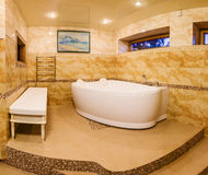 Interior modern house, bathroom with marble tiles and jacuzzi Stock Image