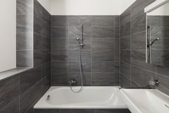 Interior of a modern house, gray bathroom Royalty Free Stock Photo