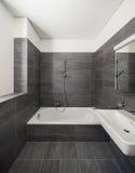 Interior of a modern house, gray bathroom royalty free stock photos