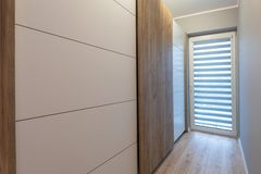 Interior of a modern house with wardrobe. Interior of a modern house with wooden wardrobe royalty free stock photo