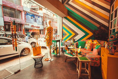 Interior of modern Indian fashion store with showcase and vintage furniture Royalty Free Stock Photography