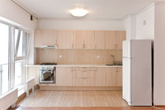 Interior of modern kitchen. Modern open-space kitchen in a new apartment Stock Photos
