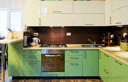 Interior of modern kitchen. Interior of modern green kitchen Royalty Free Stock Images