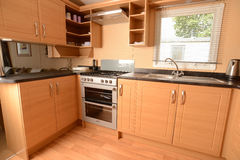 Interior of modern kitchen. Interior details of fitted modern kitchen with wooden units Stock Photos