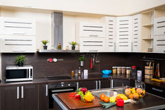 Interior of modern kitchen with fruits and vegetables Stock Photography