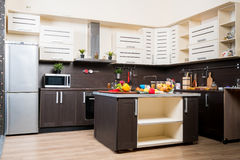Interior of modern kitchen with fruits and vegetables Royalty Free Stock Image