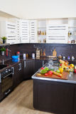 Interior of modern kitchen with fruits and vegetables Royalty Free Stock Photography