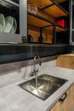 Interior of modern kitchen with metal sink royalty free stock photos