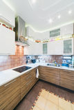 Interior of modern kitchen with tiled floor Royalty Free Stock Image