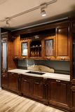 Interior of modern kitchen with wooden cabinets stock photography