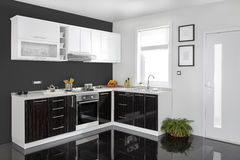 Interior of a modern kitchen, wooden furniture, simple and clean Royalty Free Stock Images