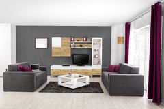 Interior of a modern living room in color Stock Photos