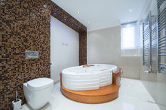 Interior of a modern luxury bathroom with jacuzzi bathtub Royalty Free Stock Images