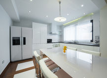 Interior of a modern luxury bright white kitchen Royalty Free Stock Image