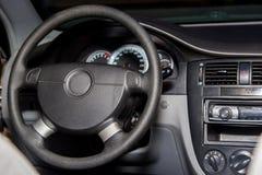Interior of a modern luxury car. Steering wheel royalty free stock photo