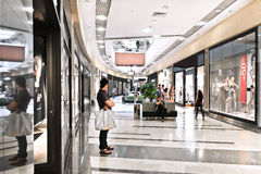 Interior of modern mall with some people in it Royalty Free Stock Image