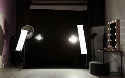 Interior of modern photo studio with dressing table. And professional lighting equipment stock photos