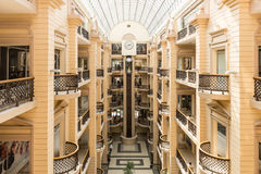 Interior modern prestigious shopping center in Moscow with balconies and elevators Royalty Free Stock Images
