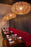Interior of modern restaurant , empty glass on table. Stock Image