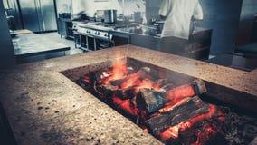 Interior of modern restaurant kitchen, fireplace stock footage