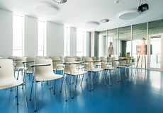 An interior of a modern spacious study room in a library or office. stock photo