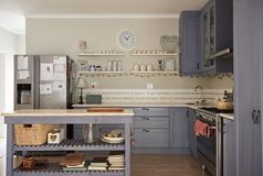 Interior of kitchen area in a country style home Stock Photos