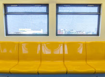 Interior of a modern subway car , sky train yellow seat Stock Photo