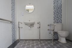 Interior Of Modern Toilet bowl in bathroom Royalty Free Stock Image