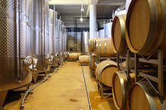 Interior of a modern underground winery with aluminium tanks and Royalty Free Stock Images