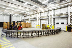 Interior of modern warehouse. Warehouse, unloading with conveyor belt Stock Photography