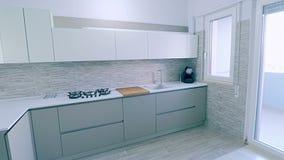 Interior moderno, brilhante, limpo, da cozinha com dispositivos de aço inoxidável e maçã do friut na tabela em uma casa luxuosa