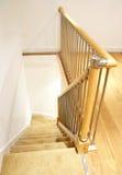 Interior moderno de la casa - escaleras con el pasamano del cromo Imágenes de archivo libres de regalías