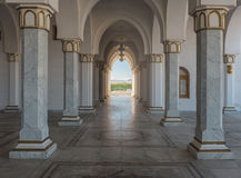 Interior of a mosque with columns. Symmetrical interior of a mosque with columns Royalty Free Stock Photography