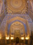 Interior of mosque dome with gold gild of Tile Karl Madrasa in T. Details of blue carved and painted interior ceiling with gold gild of the Tile Karl Madrasa in royalty free stock photo