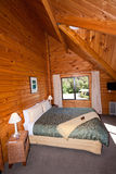 Interior of mountain wooden lodge double bedroom Stock Image