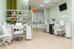 Interior nail salon and manicurist jobs in spa salon. Interior nail salon and manicurist jobs in the spa salon royalty free stock photography