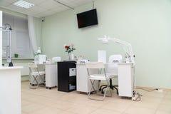 Interior nail salon and manicurist jobs in spa salon. Interior nail salon and manicurist jobs in the spa salon royalty free stock photo