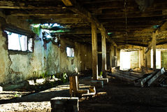 Interior of neglected cow barn Stock Photos