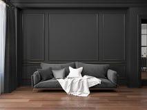 Interior negro clásico con el sofá Fotos de archivo