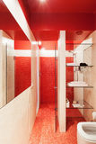 Interior new apartment, red bathroom Stock Photography