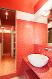 Interior new apartment, red bathroom Royalty Free Stock Images