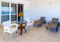 Interior of new apartment, veranda with two sunbeds Stock Images