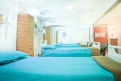 Interior of new empty hospital room fully equipped. Interior of new empty hospital, beds fully equipped Royalty Free Stock Photos
