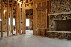 Interior of New Home Construction. Interior view of a new home under construction. A stone fireplace has been installed. Horizontal shot Stock Photography