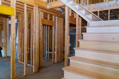 Interior of a new home wooden beams at construction residential house framing. Interior of a new home wooden beams at construction residential construction house royalty free stock photography